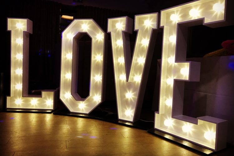 The letters LOVE in large LEDs