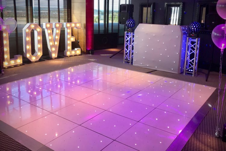 Dance floor at wedding with lights & DJ booth