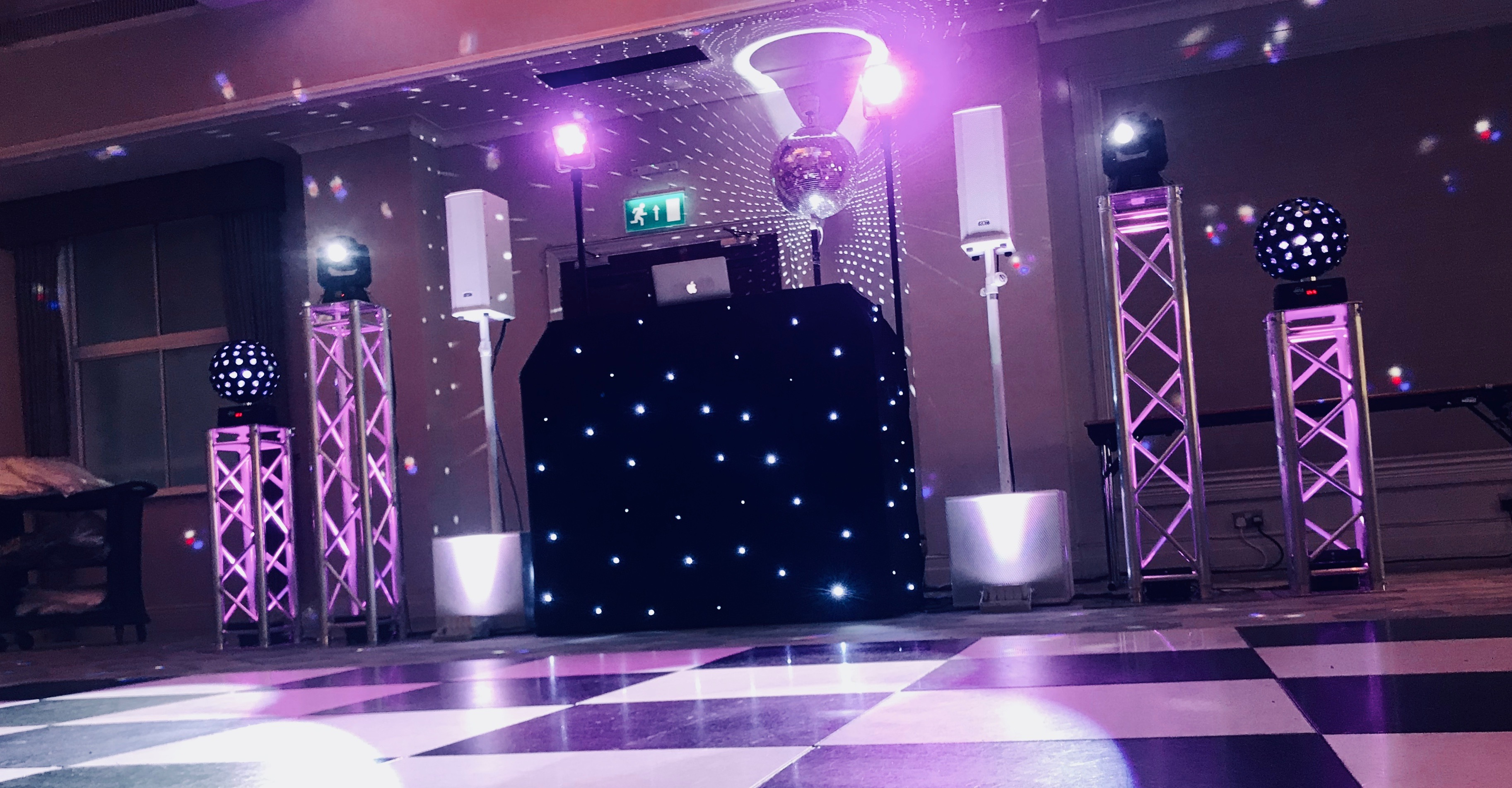 DJ booth with lighting shot from the dance floor